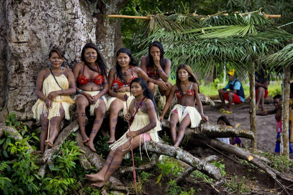 indigenous people living inside rainforest